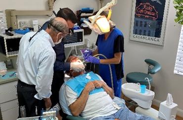 Veteran receiving dental treatment